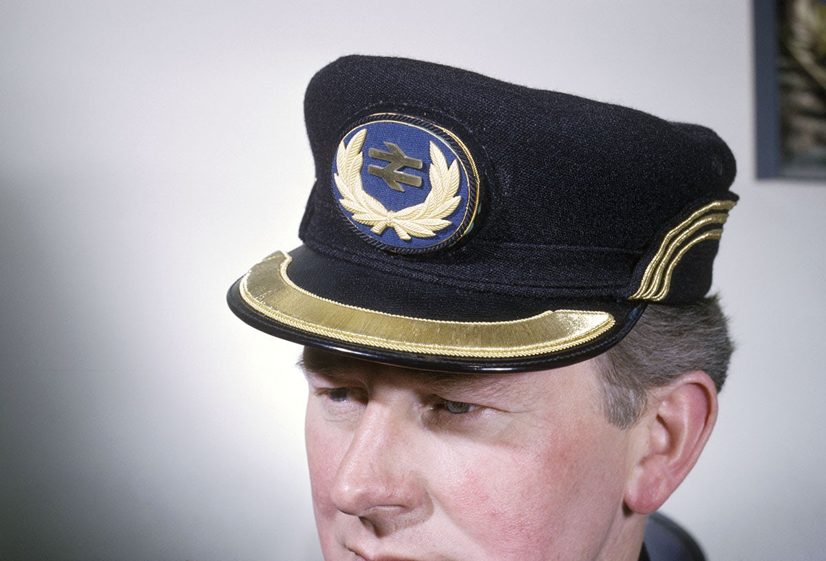 British Rail employee wearing cap with company badge, April 1964.