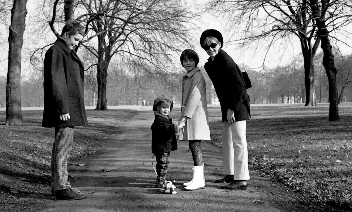 Michael, Victoria and Sarah Sellers with Britt Ekland in Hyde Park, 1967 © Sellers Family