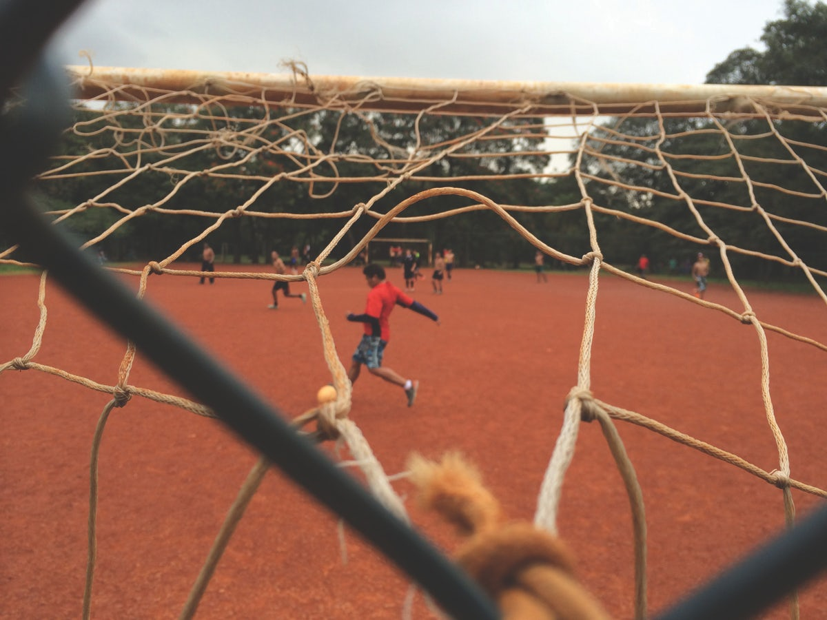 Kids playing football in Ibirapuera Park, Sao Paulo. Photo by Tom Mallion for Copa90.