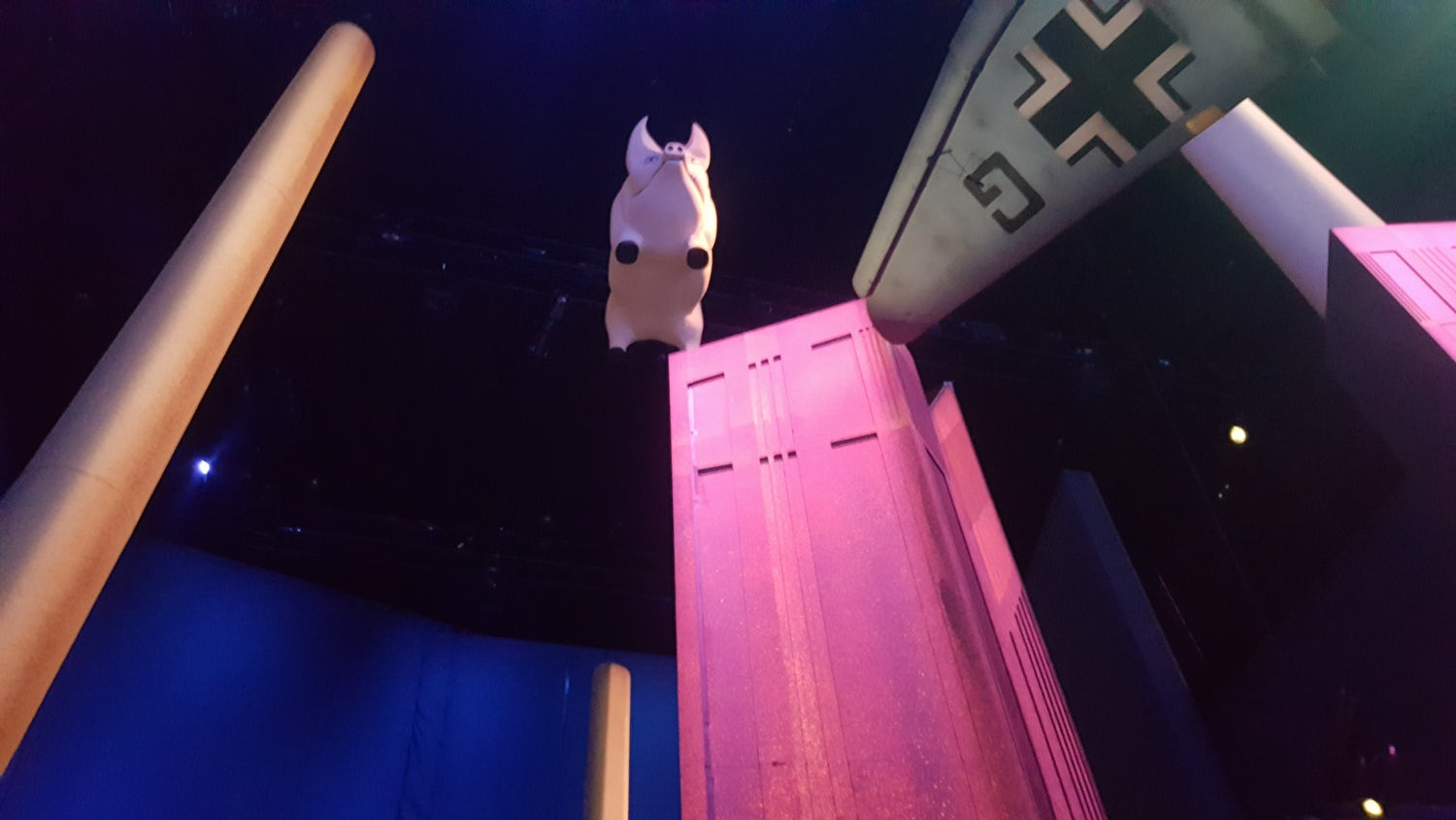 A pink pig is suspended from the ceiling above Stufish's Battersea Power Station installation