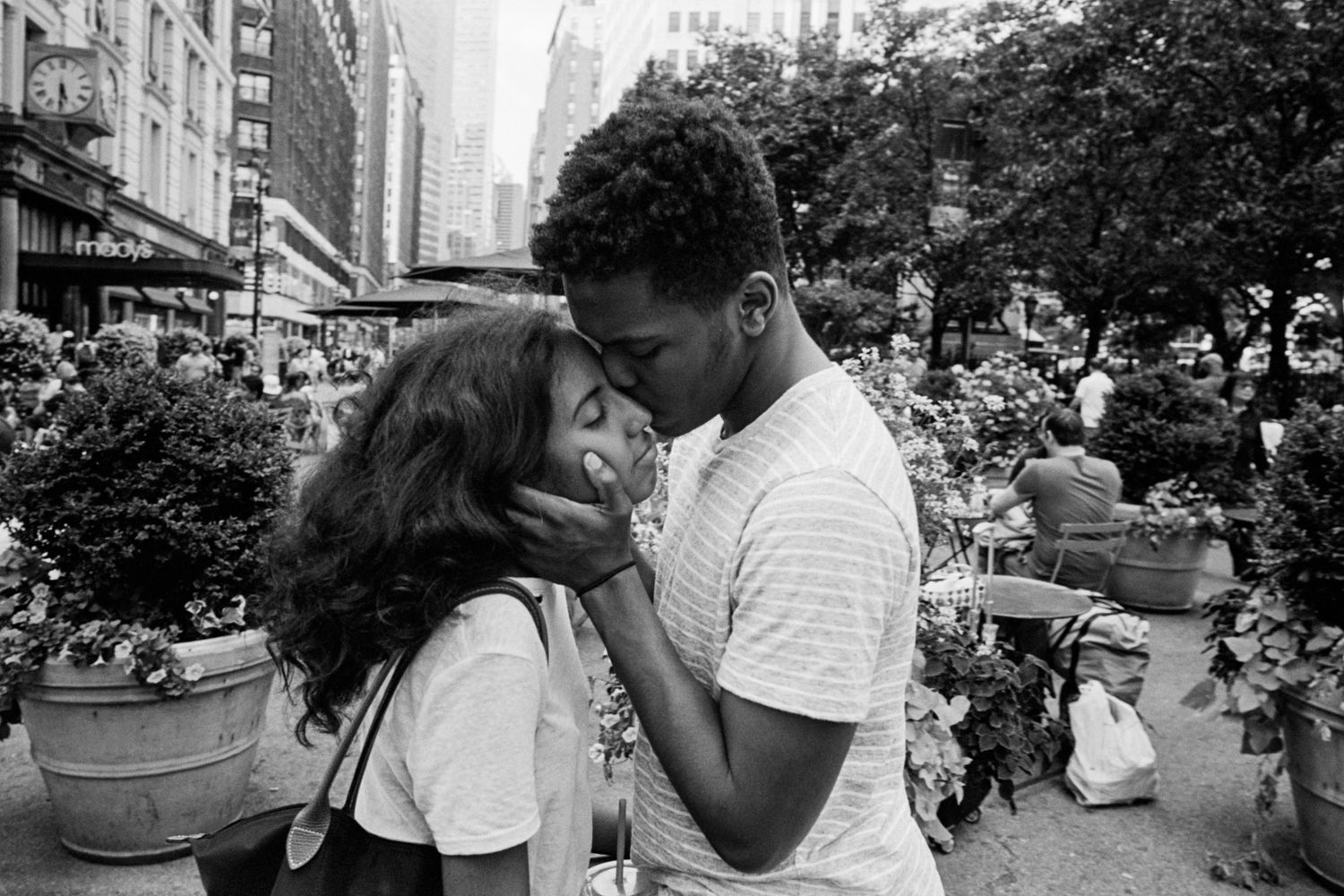 A photograph of a couple embracing by Andre D Wagner